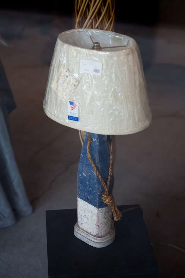 An old fishing buoy has been turned into a custom lamp at the Lighting Treasures workshop and showroom at the Design Center on Old Katy Road.  ( Photo: R. Clayton McKee, Freelance / © R. Clayton McKee