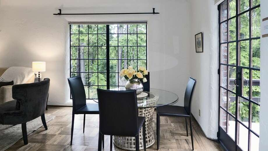 Dining room of 2635 N.W. 92nd St. The 2,360-square-foot brick Tudor, built in 1931, has four bedrooms, 1.75 bathrooms, coved and vaulted ceilings, plaster walls, iron detailing, a rec room, a balcony and two fireplaces on one-third of an acre. It's listed for $773,000, although a sale is pending. Photo: Courtesy Gloria Jackson, Windermere Real Estate
