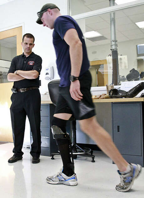 Army 1st Lt. Matthew Anderson, an infantry platoon leader with an injured lower leg, tries out the fit of an adjusted Intrepid Dynamic Exoskeletal Orthosis, or IDEO, as Ryan Blanck, the device's creator, watches him walk at the Center for the Intrepid at Joint Base San Antonio-Fort Sam Houston. Photo: U.S. Army