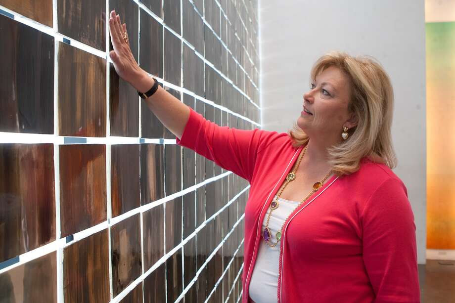 For a dozen years, Pearland's Susan Myers helped promote the Holocaust Museum Houston as its executive director. Above, she looks at the museum's Wall of Tears. Each square represents 10,000 victims of the Holocaust. She's resting after her May 1 retirement from the museum before she moves on to what's next.        For a dozen years, Pearland's Susan Myers helped promote the Holocaust Museum Houston as its executive director. Above, she looks at the museum's Wall of Tears. Each square represents 10,000 victims of the Holocaust. She's resting after her May 1 retirement from the museum before she moves on to what's next. Photo: R. Clayton McKee, Freelance / © R. Clayton McKee