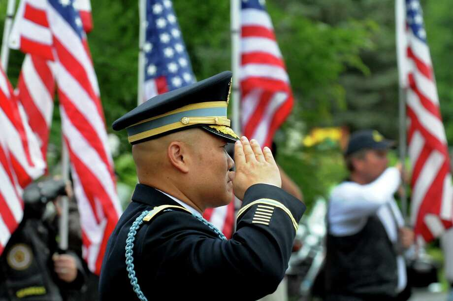 A member of the military salutes following the funeral of Lt. Col. Todd Clark on Tuesday, June 18, 2013, at St. Madeleine Sophie Church in Guilderland, N.Y. (Cindy Schultz / Times Union) Photo: Cindy Schultz / 10022856A