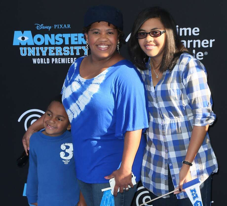 "HOLLYWOOD, CA - JUNE 17:  Actress Chandra Wilson (C) attends the premiere of Disney Pixar's ""Monsters University"" at the El Capitan Theatre on June 17, 2013 in Hollywood, California.  (Photo by David Livingston/Getty Images)"