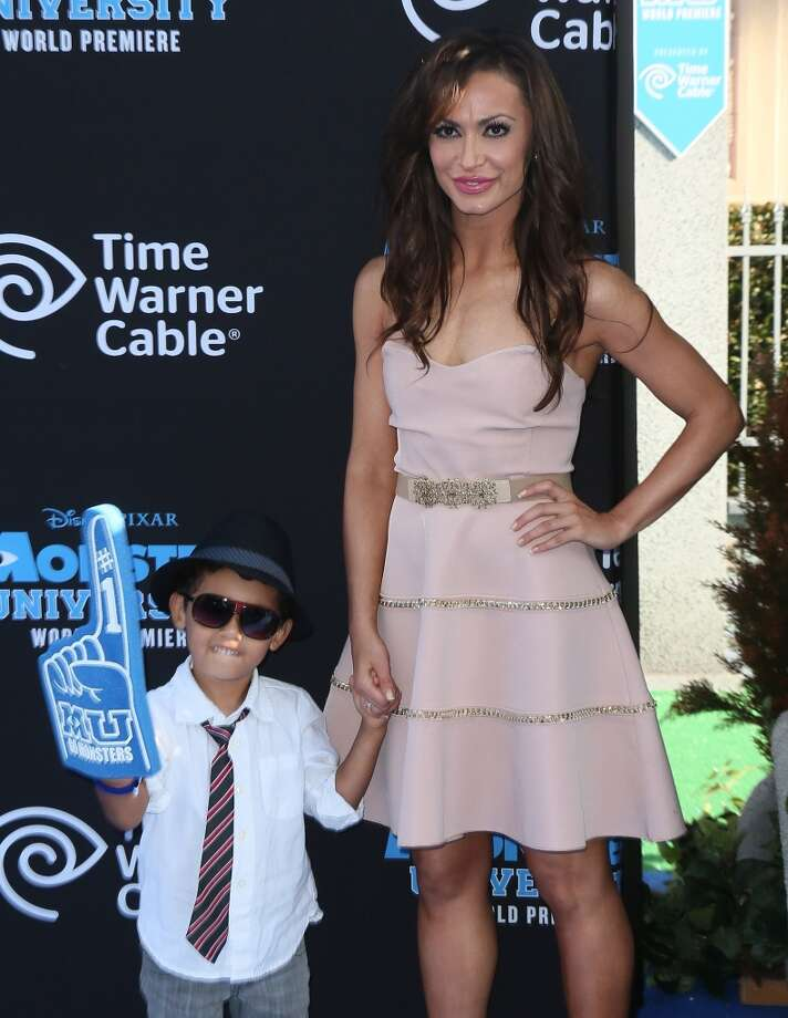 "HOLLYWOOD, CA - JUNE 17:  TV personality Karina Smirnoff (R) and God son Royce attend the premiere of Disney Pixar's ""Monsters University"" at the El Capitan Theatre on June 17, 2013 in Hollywood, California.  (Photo by David Livingston/Getty Images)"