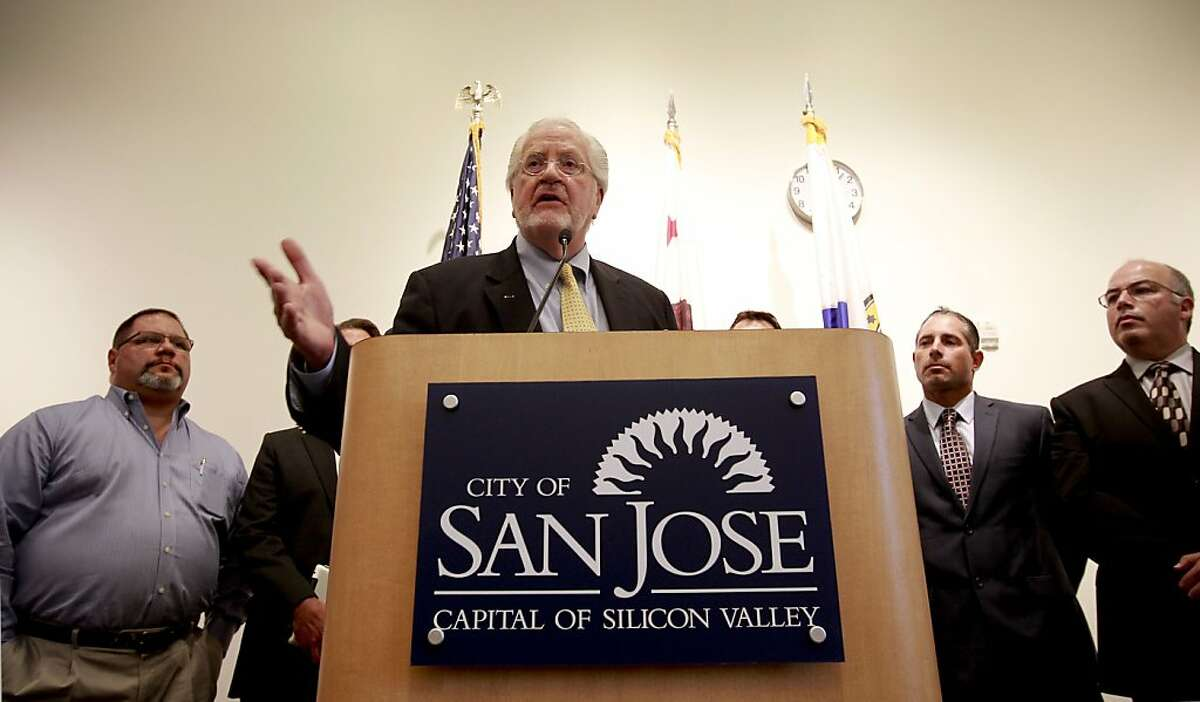 Attorney Joe Cotchett, who filed the lawsuit is surrounded by San Jose city officials speaks out during a press conference to discuss the lawsuit at City Hall in San Jose, Calif. on Tuesday June 18, 2013. The city of San Jose has filed a lawsuit against Major League Baseball to get the Oakland A's a new ballpark in the South Bay, the lawsuit will challenge the Giants claim to rights over the region as well as MLB's long-standing monopoly over everything baseball.