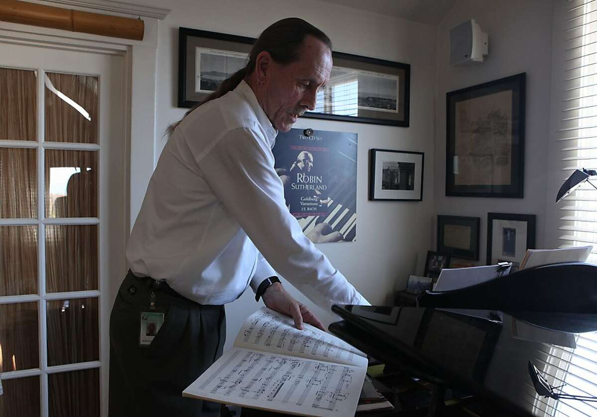 San Francisco symphony pianist Robin Sutherland goes through music sheets at home in San Francisco , Calif., on Wednesday, June 12, 2013. He will be celebrating his 40th year with the SF Symphony this year.