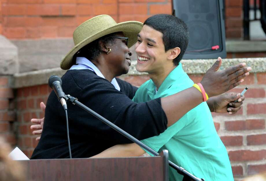Andrew Ortega, hugging teacher Glenda Armstrong, is the winner of the ACE of Diamonds Award and the Patrick Cappellano Award at his high school graduation Tuesday. The Alternative Center for Excellence in Danbury, Conn. held it's graduation ceremony at the Locust Avenue school building, Tuesday, June 18, 2013. Photo: Carol Kaliff / The News-Times
