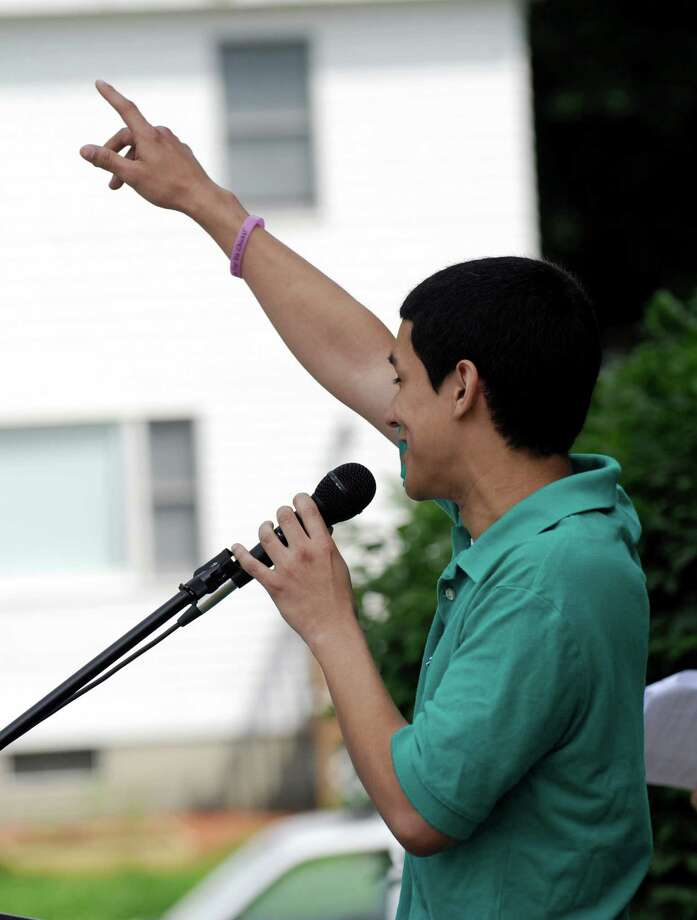 Andrew Ortega speaks at his high school graduation Tuesday. The Alternative Center for Excellence in Danbury, Conn. held it's graduation ceremony at the Locust Avenue school building, Tuesday, June 18, 2013. Photo: Carol Kaliff / The News-Times