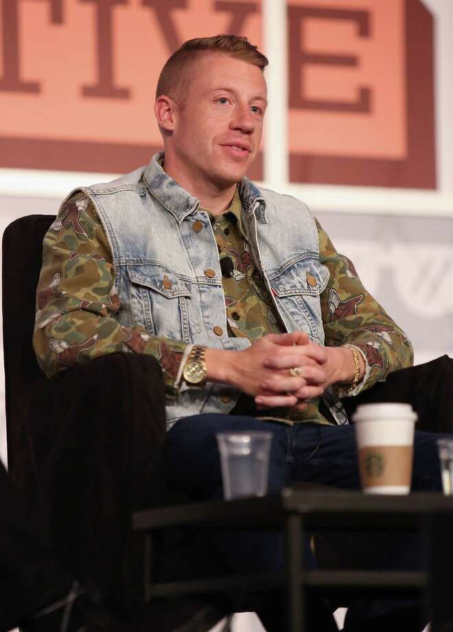 A jean vest really is the best way to dress up a camo shirt. Photo: Mindy Best, Getty Images / 2013 Mindy Best