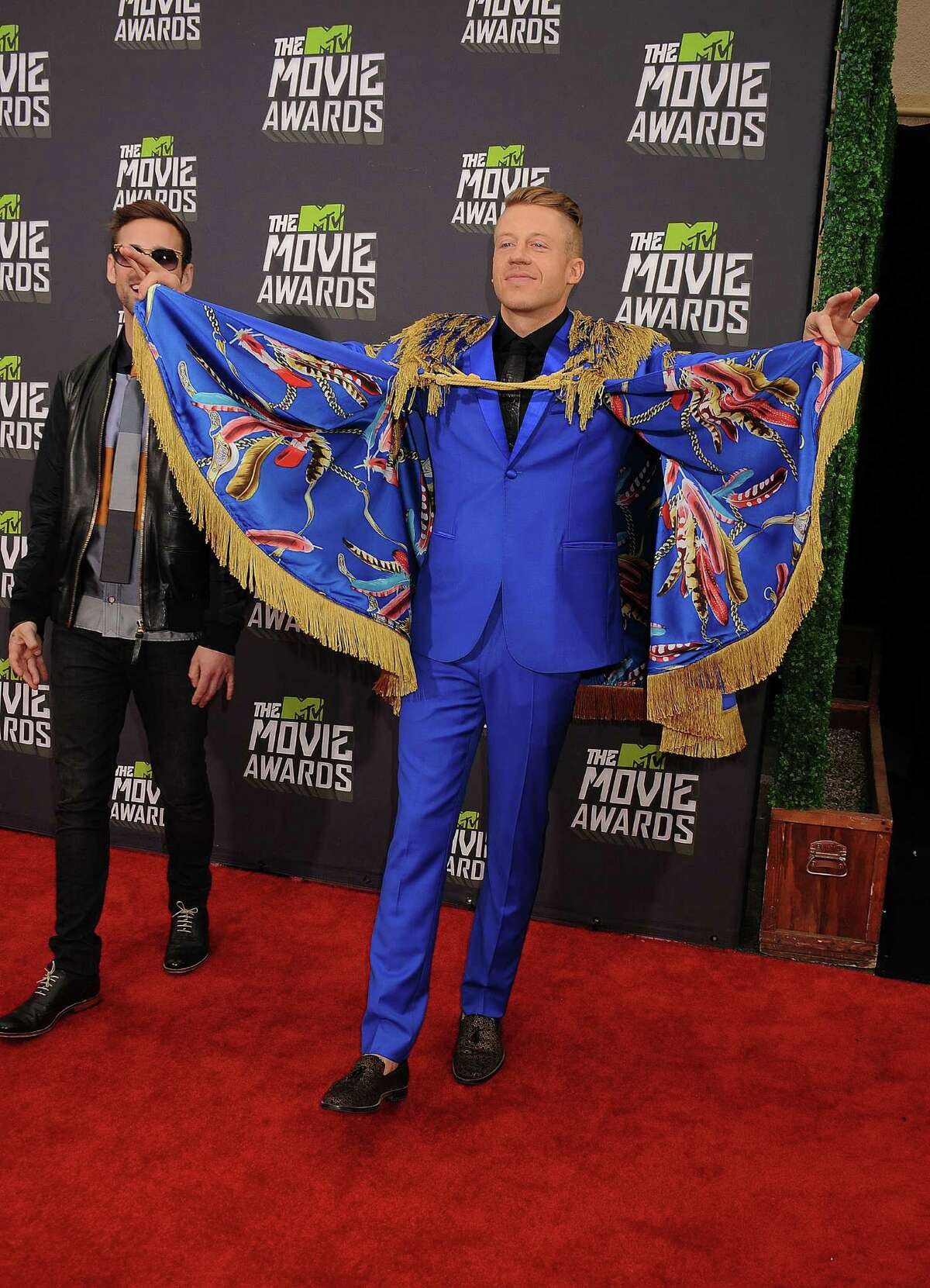 You probably wonder why this thing -- formal evening cape, maybe -- even exists. Here's why ... (Photo by Jeffrey Mayer/WireImage)