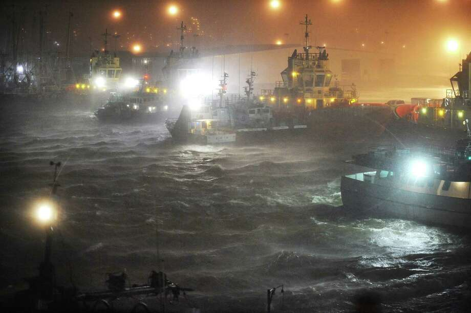 Boats anchored for safety in the Port of Beaumont thrash wildly as Hurricane Ike roars ashore in September 2008. Enterprise file photo / Beaumont