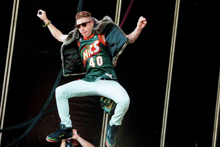 Macklemore flying his Sonics colors in Philadelphia. Photo: Jeff Fusco, Getty / 2013 Jeff Fusco