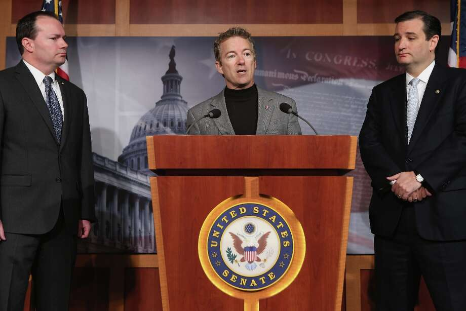 WASHINGTON, DC - MARCH 13:  Sen. Rand Paul (R-KY) speaks during a news conference with Sen. Mike Lee (R-UT) (L) and Sen. Ted Cruz (R-TX) to announce a plan to defund the Patient Protection and Affordable Care Act, also known as Obamacare, at the U.S. Capitol March 13, 2013 in Washington, DC. Although the conservative senators sponsoring the legislation expect it to fail, they believe it is an important survey of who supports health care reform. Photo: Chip Somodevilla, Getty Images / 2013 Getty Images