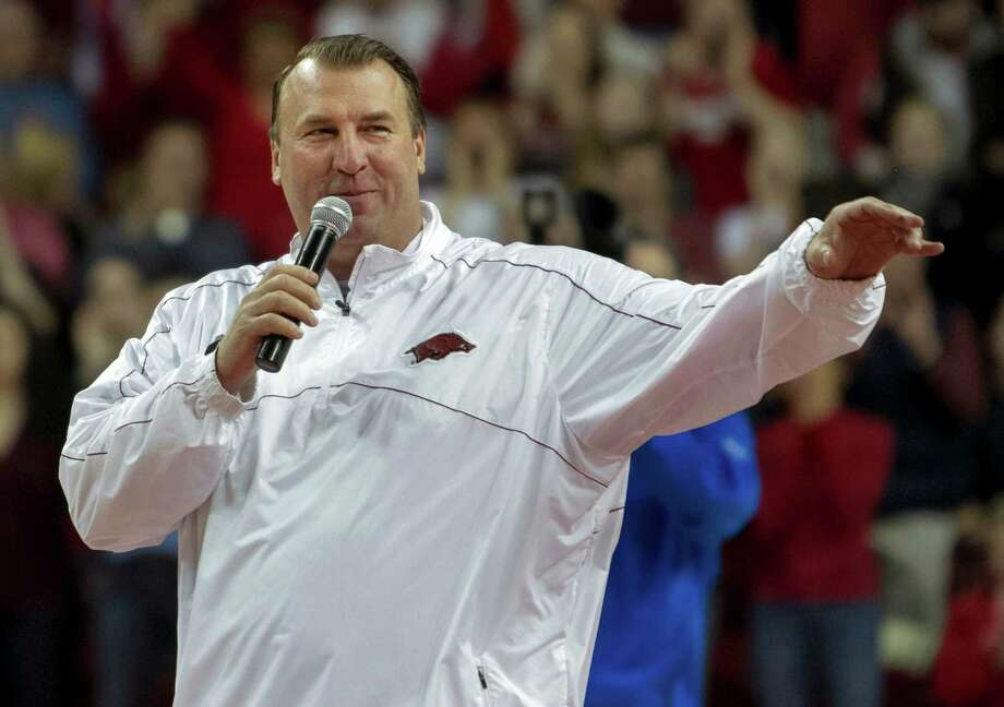 Arkansas head football coach Bret Bielema speaks during a time out in the first half an NCAA college basketball game against Tennessee in Fayetteville, Ark., Saturday, Feb. 2, 2013. Arkansas defeated Tennessee 73-60. (AP Photo/Gareth Patterson) Photo: Gareth Patterson, Associated Press / FR170364 AP