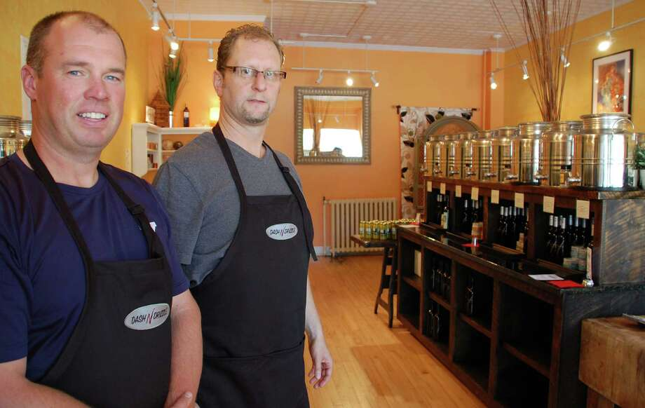 Jeff Love, left, and Jeff Stein are bringing some taste to downtown Fairfield with their new olive oil and balsamic vinegar tasting store, Dash 'N Drizzle, at 11 Unquowa Road. Photo: Jarret Liotta / Fairfield Citizen