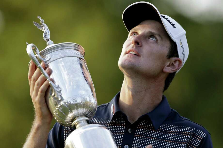 After winning the U.S. Open on Sunday — the first for an Englishman since 1970 — Justin Rose looks toward the sky in tribute to his father, Ken, who died of leukemia in 2002. Photo: Darron Cummings / Associated Press