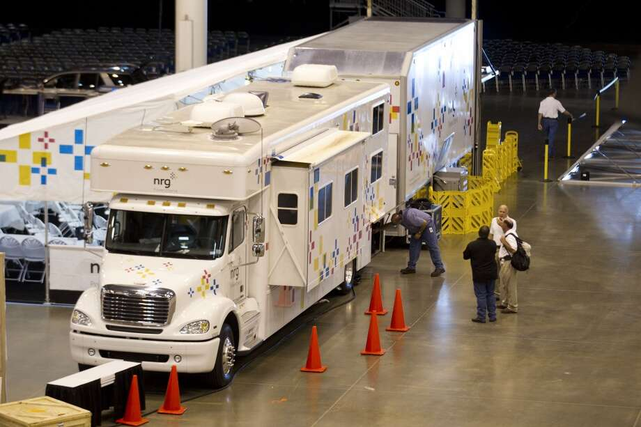 A new solar-diesel powered disaster relief vehicle and 26-foot trailer is put on display at Reliant Center Tuesday, June 18, 2013, in Houston. The vehicle is designed to deliver immediate power, emergency shelter, access to news and information and Wi-Fi internet connectivity to those in need. Photo: Brett Coomer, Houston Chronicle