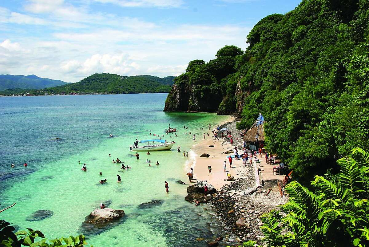 Hidden between the Jaltemba Bay and the Sierra Madre Occidental Mountains, Rincon de Guayabitos offers miles of beach and ocean waters so calm it's called