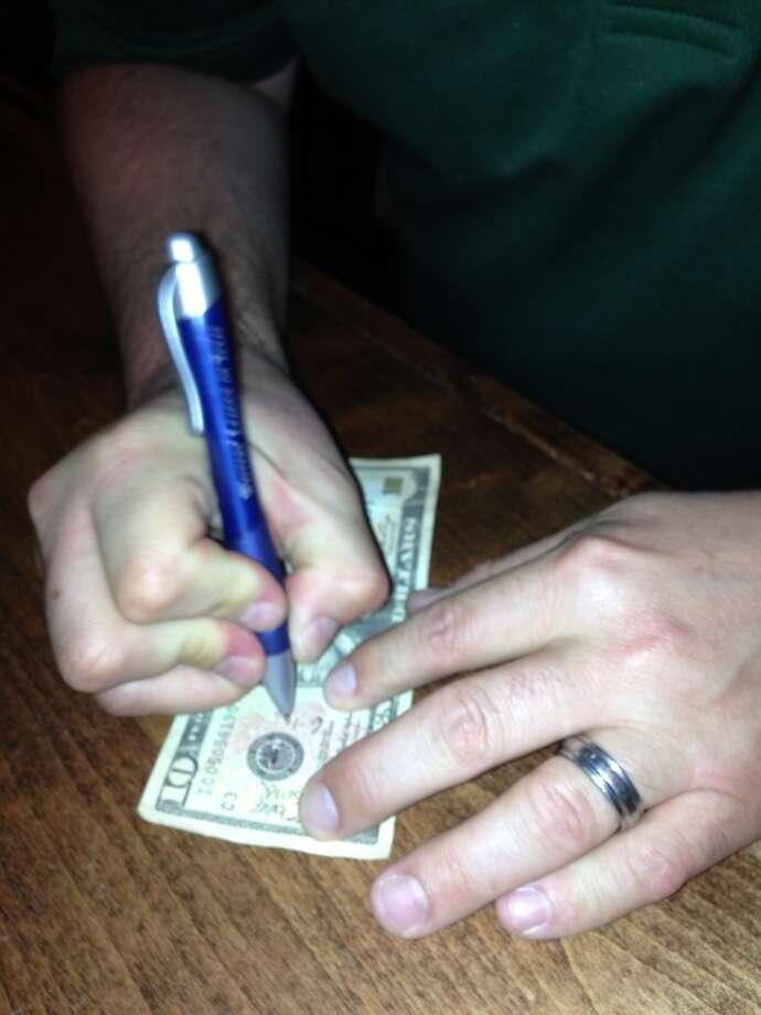 Ambrose signed Edwards' $10 bill for a brewery keepsake.