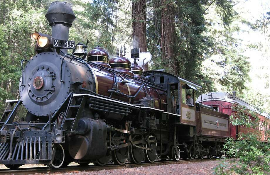 "Engine #45 of the ""Super Skunk"" train awaits the ""All Aboard!"" call of the conductor while surrounded by giant Redwoods at Northspur Station. Photo: Robert Jason Pinoli"