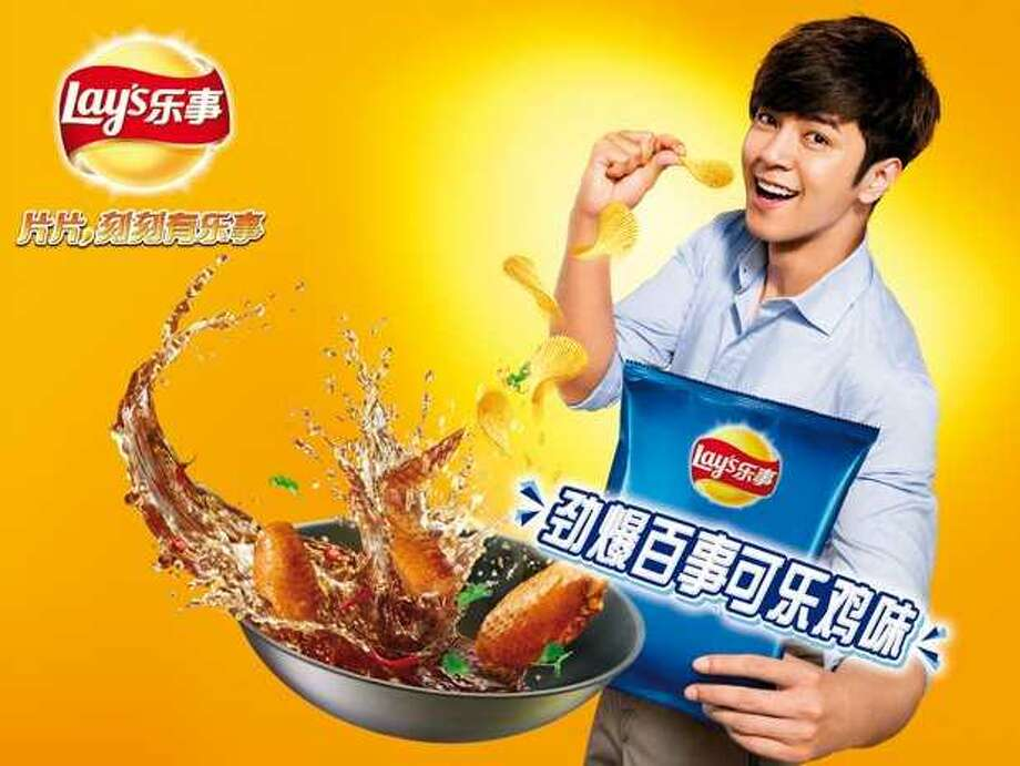 Lay's Pepsi & Chicken-flavored potato chips (Asia)  What we assume it tastes like: Staying home to play Xbox because you got turned down for prom.