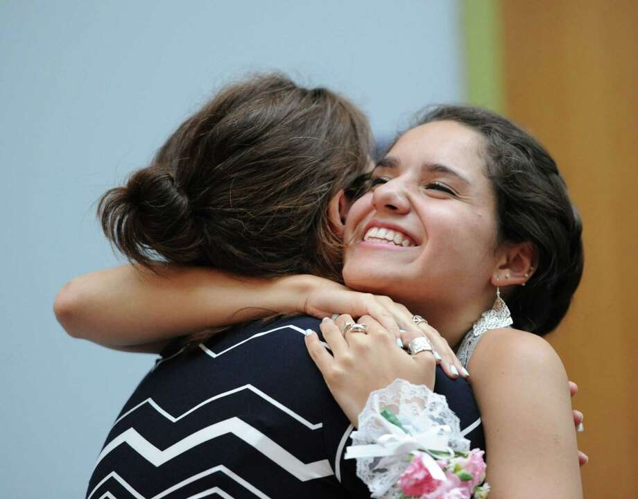 At right, Gabriela Franchin, 17, a Greenwich High School senior, hugs her teacher Melissa Brown, during the graduation ceremony for Greenwich High School students who participated in the school's Advancement Via Individual Determination (AVID) program, at the University of Connecticut in Stamford, Tuesday night, June 18, 2013. Franchin said she will be attending the University of Connecticut in the fall. Photo: Bob Luckey / Greenwich Time