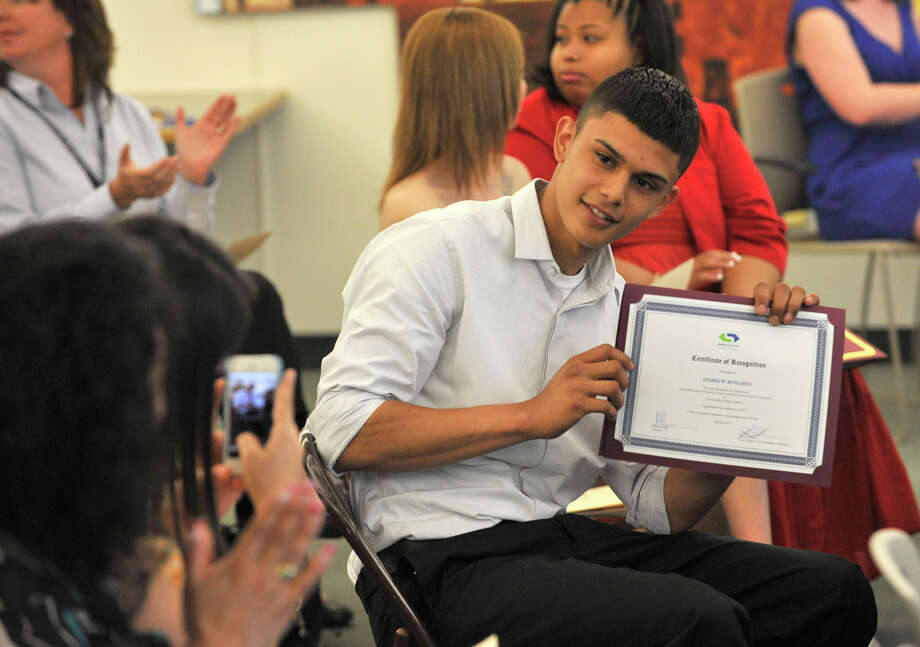 Andrew Rosario poses for a photograph with his certificate during the Alternative Routes to Success Program, Home Instruction Department and Out-of-District Program recognition ceremony at the Government Center in Stamford on Tuesday, June 18, 2013. Photo: Jason Rearick / Stamford Advocate