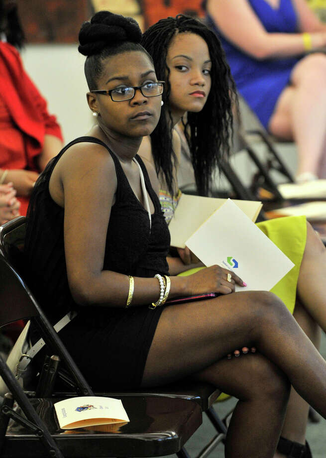 India Garnett , left, and Caresse Stinson listen during the Alternative Routes to Success Program, Home Instruction Department and Out-of-District Program recognition ceremony at the Government Center in Stamford on Tuesday, June 18, 2013. Photo: Jason Rearick / Stamford Advocate