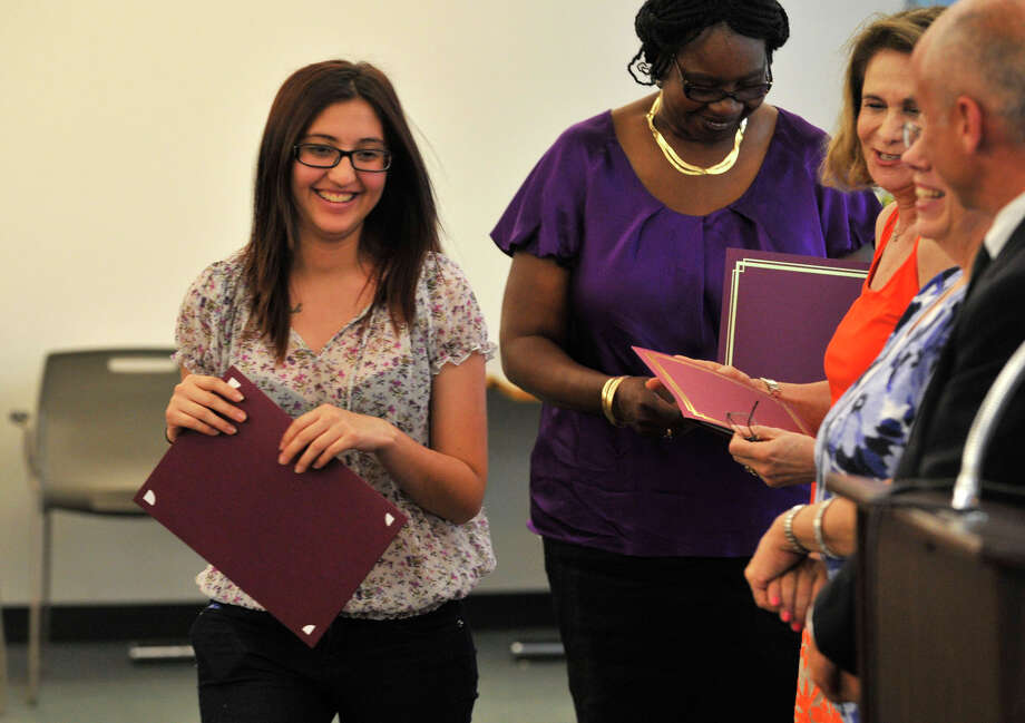 Karen Ortega Escobar accepts her certificate during the Alternative Routes to Success Program, Home Instruction Department and Out-of-District Program recognition ceremony at the Government Center in Stamford on Tuesday, June 18, 2013. Photo: Jason Rearick / Stamford Advocate