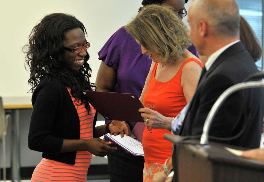 Latrice Whyte accepts her certificate during the Alternative Routes to Success Program, Home Instruction Department and Out-of-District Program recognition ceremony at the Government Center in Stamford on Tuesday, June 18, 2013. Photo: Jason Rearick / Stamford Advocate
