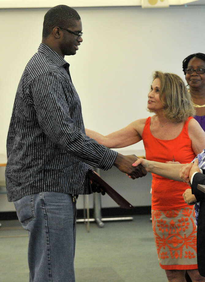 Adam Worrell accepts his certificate during the Alternative Routes to Success Program, Home Instruction Department and Out-of-District Program recognition ceremony at the Government Center in Stamford on Tuesday, June 18, 2013. Photo: Jason Rearick / Stamford Advocate