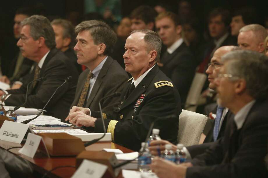 Gen. Keith Alexander, the head of the National Security Agency (in uniform), testifies before the House Intelligence Committee in Washington. Photo: Charles Dharapak / Associated Press