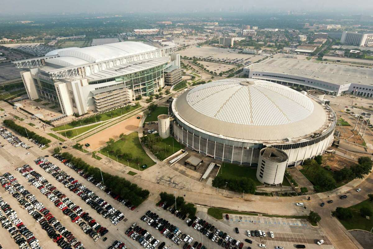 Reliant Stadium and the Reliant Astrodome are seen in an aerial view on Saturday, May 18, 2013, in Houston.