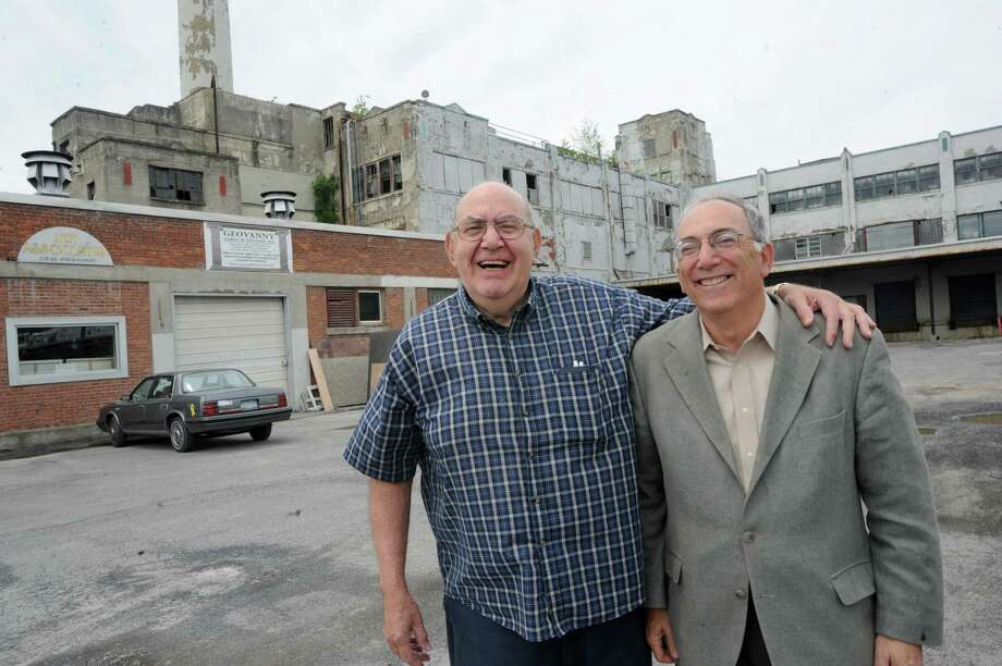 Retired Tobin worker Richie Zaccardo, 77, left, and Robert Ganz, an attorney partner in Exchange Street Partners, who own the former Tobin packing plant, stand in front of the plant known as First Prize Center on Tuesday, June 18, 2013 in Albany, N.Y.  (Lori Van Buren / Times Union) Photo: Lori Van Buren / 10022865A