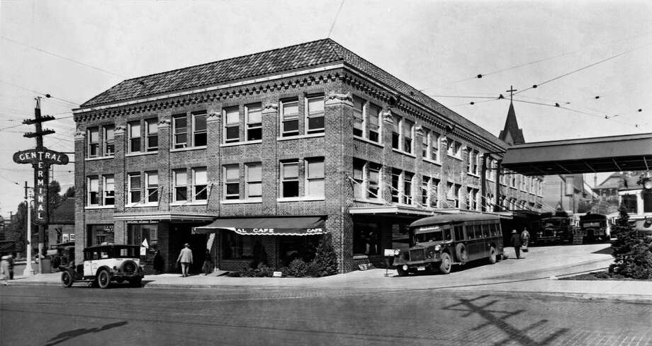 The station opened at Eighth and Stewart in 1927 as a railcar depot called the Central Terminal, pictured. Greyhound took over in 1947, when the station was busy in a post-World War II economy.    (Asahel Curtis photo, pauldorpat, via Nicholson Kovalchick Architects and Seattle Landmarks Preservation Board)