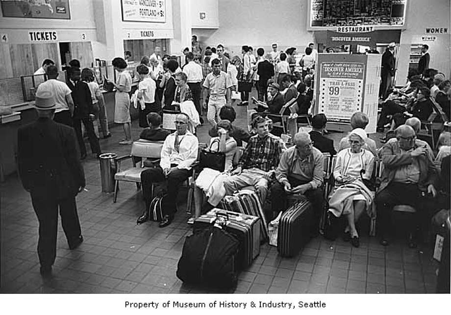 Bus travel has waned dramatically over the decades. The scene here -- inside the Seattle station in 1966 -- was an exception. It was taken during an airline strike.  (Photo: Stuart Hertz, copyright MOHAI, Seattle Post-Intelligencer collection, 1986.5.9080.6).