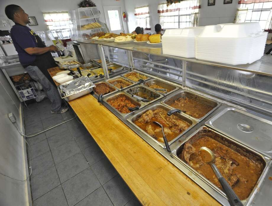 Near the dinning area, Adam Crawford is behind the counter where the steam table is. Willie Mae's, a soul food restaurant on Fannett Road in Beaumont, is the June 13 restaurant of the week. Dave Ryan/The Enterprise