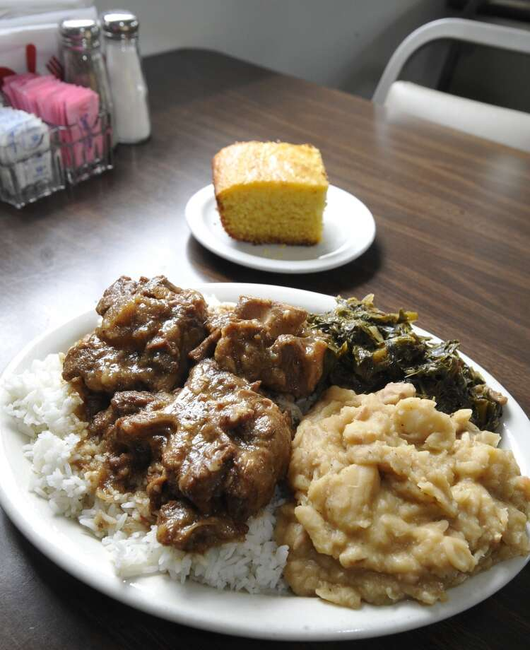 A plate of Ox Tail and rice, mixed greens, lima beans and cornbread. Willie Mae's, a soul food restaurant on Fannett Road in Beaumont, is the June 13 restaurant of the week. Dave Ryan/The Enterprise