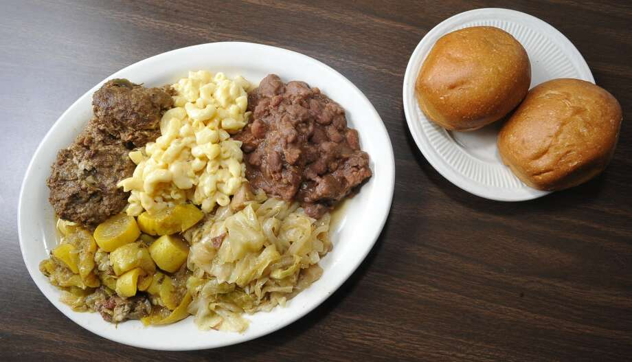 A plate of meatballs, macaroni and cheese, redbeans and sausage,  squash and cabbage and rolls. Willie Mae's, a soul food restaurant on Fannett Road in Beaumont, is the June 13 restaurant of the week. Dave Ryan/The Enterprise