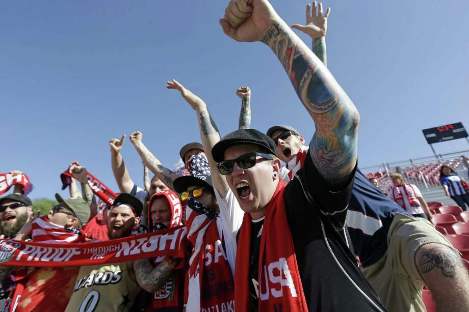 U.S. soccer fans cheer before the start an World Cup qualifying soccer match against Honduras at Rio Tinto Stadium on Tuesday, June 18, 2013, in Sandy, Utah.  (AP Photo/Rick Bowmer) Photo: Rick Bowmer, Associated Press / AP