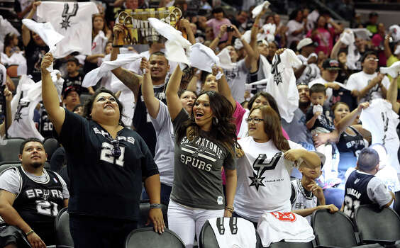 Spurs fans cheer the team after the concert at the AT&T Center before game 6 of the NBA Finals  on June 19, 2013. Photo: TOM REEL