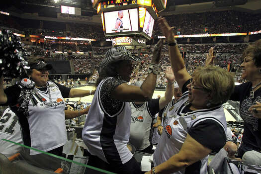 Spurs fans (from left) Bonnie Keammerer, Peggy Dickerson and Diana Guadiano celebrate Spurs baskets in the stands after the concert at the AT&T Center before game 6 of the NBA Finals  on June 19, 2013. Photo: Tom Reel, San Antonio Express-News