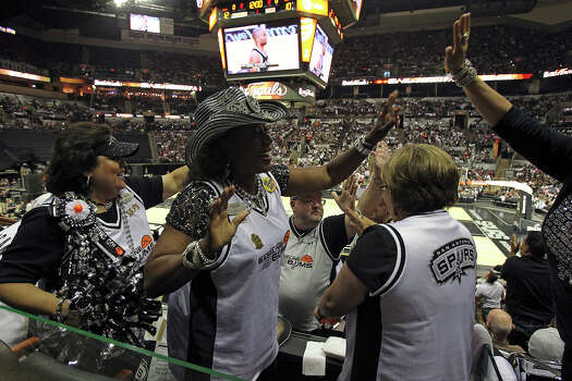 Spurs fans (from left) Bonnie Keammerer, Peggy Dickerson and Diana Guadiano celebrate Spurs baskets in the stands after the concert at the AT&T Center before game 6 of the NBA Finals  on June 19, 2013. Photo: TOM REEL