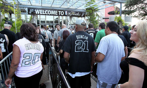 Fans go through the security check to get into the Rat Ranch concert at the AT&T Center before game 6 of the NBA Finals  on June 19, 2013. Photo: Tom Reel, San Antonio Express-News
