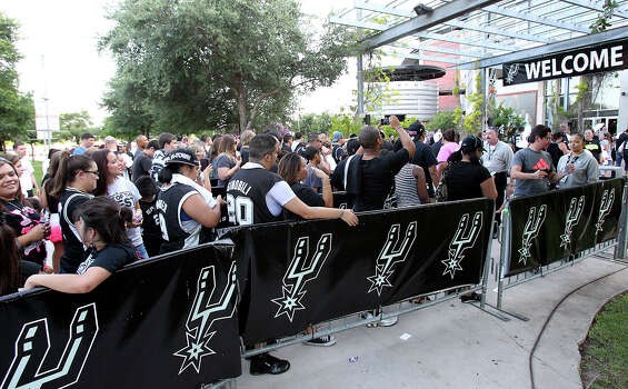 Fans line up to go through security to get into the Rat Ranch concert at the AT&T Center before game 6 of the NBA Finals  on June 19, 2013. Photo: Tom Reel, San Antonio Express-News