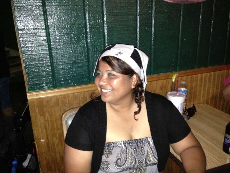 "Tina DeLaGarza, 34, was at Gulch, on Losoya Street downtown, in 2005 when the Spurs won the championship against the Detroit Pistons. She tried to make it back to the same bar in '07 but got caught in traffic. She said she's superstitious, to a degree. ""Yeah, somewhat,"" she said, wearing a black and white jester-style Spurs hat she bought years ago from a street vendor. ""Kind of yeah. You want to get into that same kind of groove."" Photo: Benjamin Olivo / MySA.com"