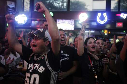 Left to right: Erik Estrada, Luis Lara, and Sabrina Chavez, all of San Antonio, cheer during the NBA Finals at Ticket Sports Pub on Tuesday, June 18, 2013. Photo: Abbey Oldham, San Antonio Express-News / © San Antonio Express-News