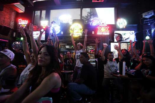 Fans do the wave during the NBA Finals at Ticket Sports Pub on Tuesday, June 18, 2013. Photo: Abbey Oldham, San Antonio Express-News / © San Antonio Express-News