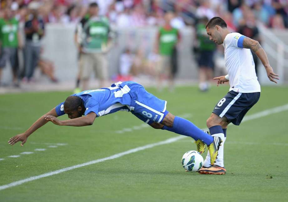 Wilson Palacios of Honduras (L) falls as Clint Dempsey of USA (R)  challenges for the ball during their Brazil 2014 FIFA World Cup qualifier at Rio Tinto Stadium in Sandy, Utah June 18, 2013.  AFP PHOTO / ROBYN BECKROBYN BECK/AFP/Getty Images Photo: ROBYN BECK, AFP/Getty Images / AFP