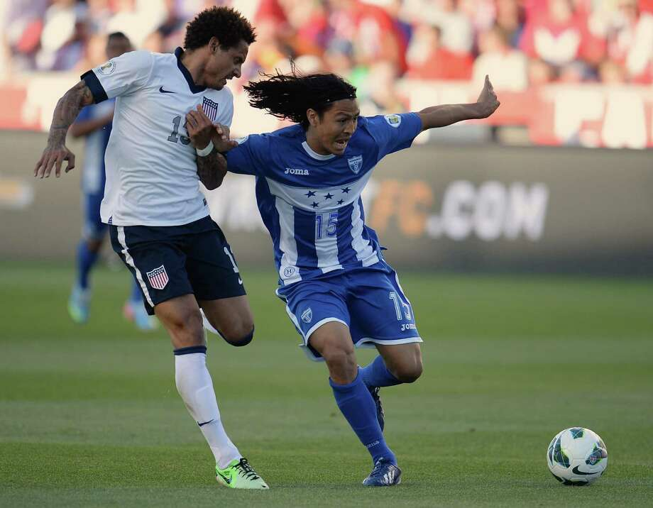 Jermaine Jones of the USA (L) and Roger Espinoza of Honduras clash during their Brazil 2014 FIFA World Cup qualifier at Rio Tinto Stadium in Sandy, Utah June 18, 2013.  AFP PHOTO / ROBYN BECKROBYN BECK/AFP/Getty Images Photo: ROBYN BECK, AFP/Getty Images / AFP