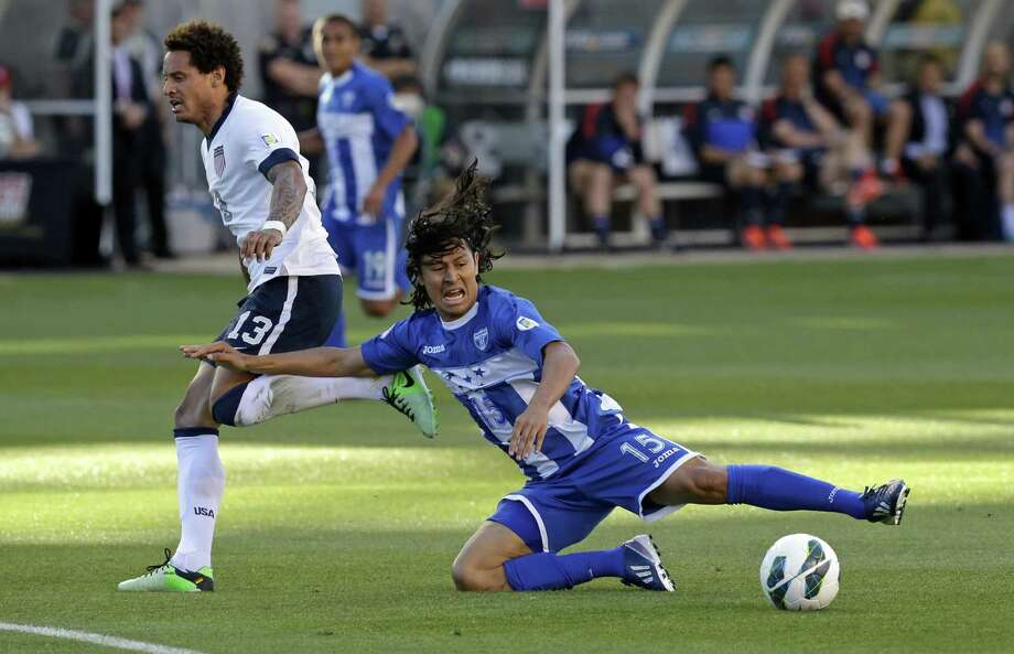 Honduras' Roger Espinoza (15) falls as United States' Jermaine Jones (13) defends in the first half during a World Cup qualifying soccer match at Rio Tinto Stadium on Tuesday, June 18, 2013, in Sandy, Utah. (AP Photo/Rick Bowmer) Photo: Rick Bowmer, Associated Press / AP
